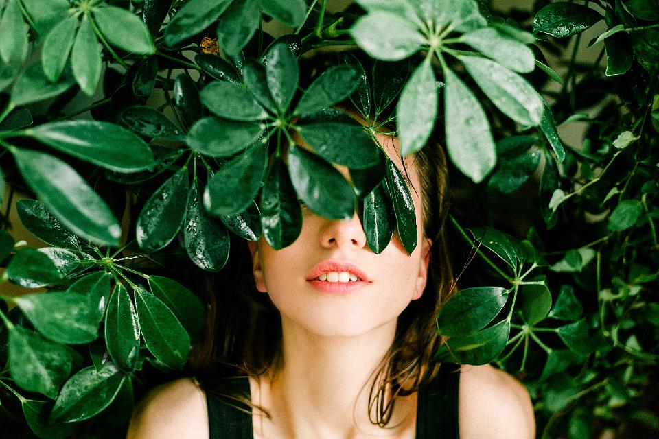 girl behind leaves