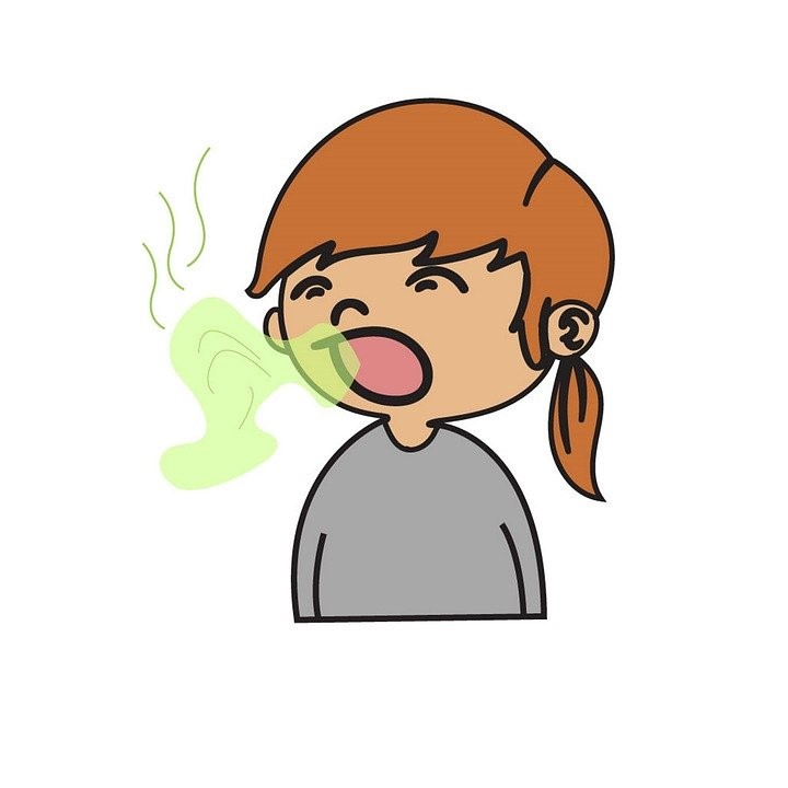 Girl with open mouth and bad breath