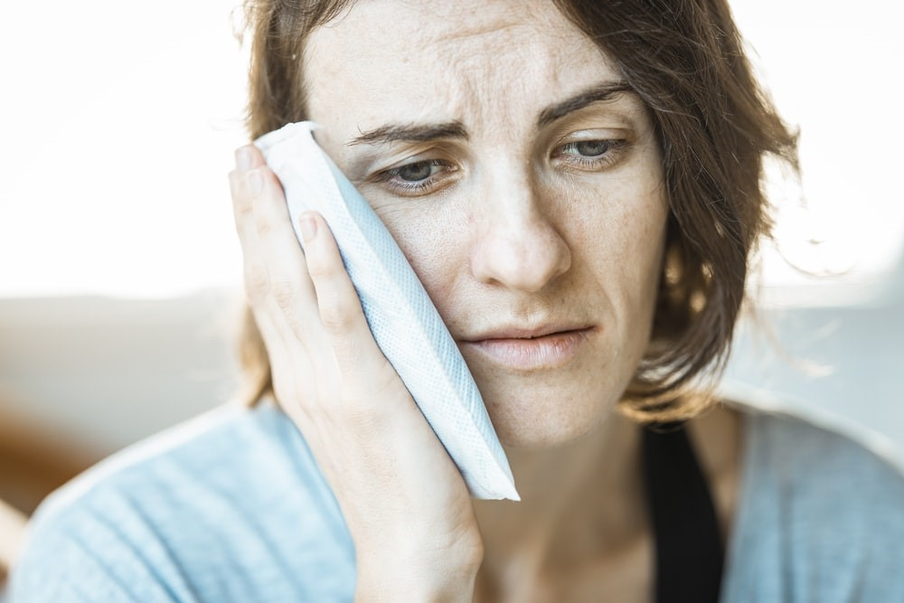 A woman experiencing toothache