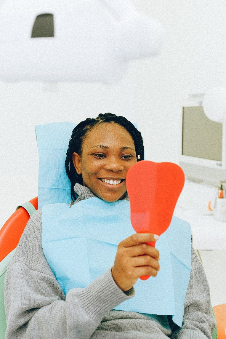 woman smiling at the dentist's office