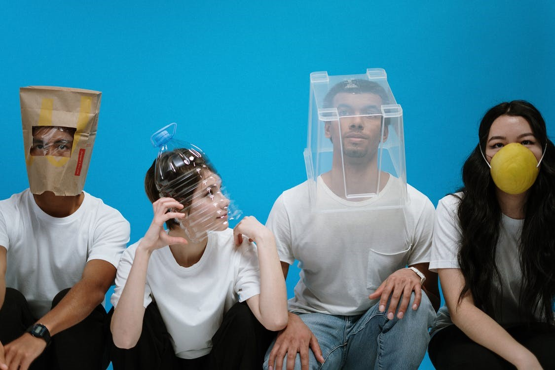 Four people wearing DIY masks to avoid bad breath