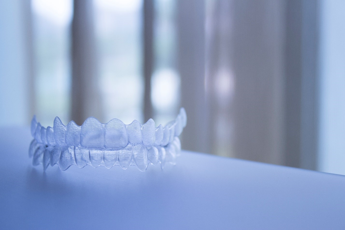 Invisible braces on a white tabletop