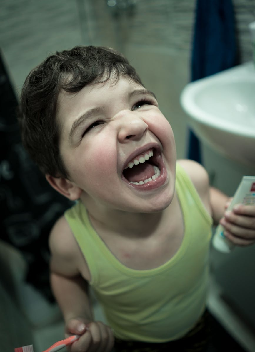 Excited child holding a toothbrush