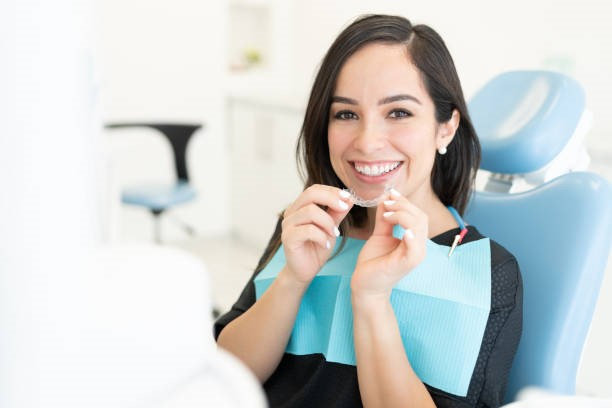 Woman smiling while sitting at a West Hills, CA dentist clinic