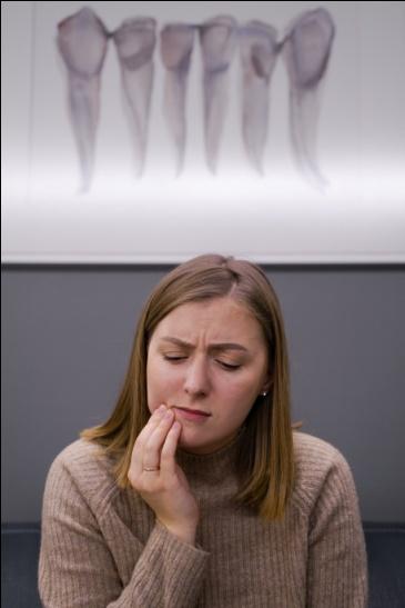 Girl having toothache